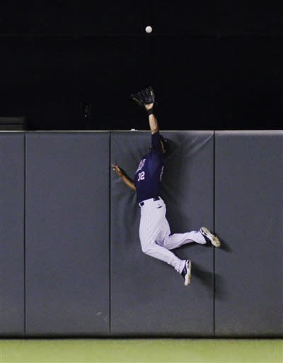 Minnesota Twins center fielder Aaron Hicks makes a leaping catch against Chicago White Sox's Adam Dunn's fly to center during the sixth inning of a baseball game, Monday, May 13, 2013, in Minneapolis. (AP Photo/Genevieve Ross)