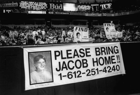 Vigil at Vikings-Rams game in stands where signs w. photos of Jacob Wetterling who was kidnapped in home town are being displayed & held in support in solving kidnapping case. (Photo by Gerald R. Brimacombe/The LIFE Images Collection/Getty Images)