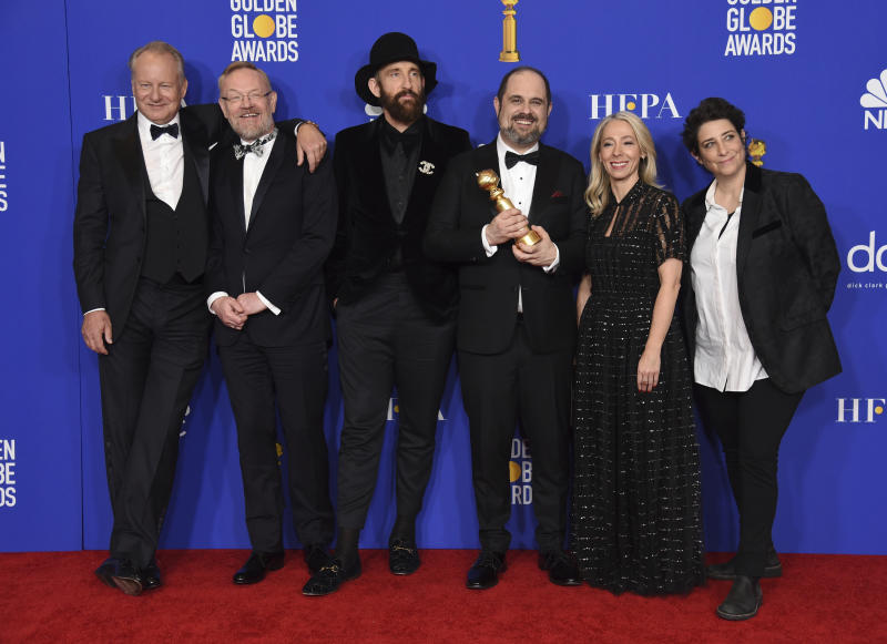 "The cast and crew of ""Chernobyl"" pose in the press room with the award for best television limited series or motion picture made for television at the 77th annual Golden Globe Awards at the Beverly Hilton Hotel on Sunday, Jan. 5, 2020, in Beverly Hills, Calif. (AP Photo/Chris Pizzello)"