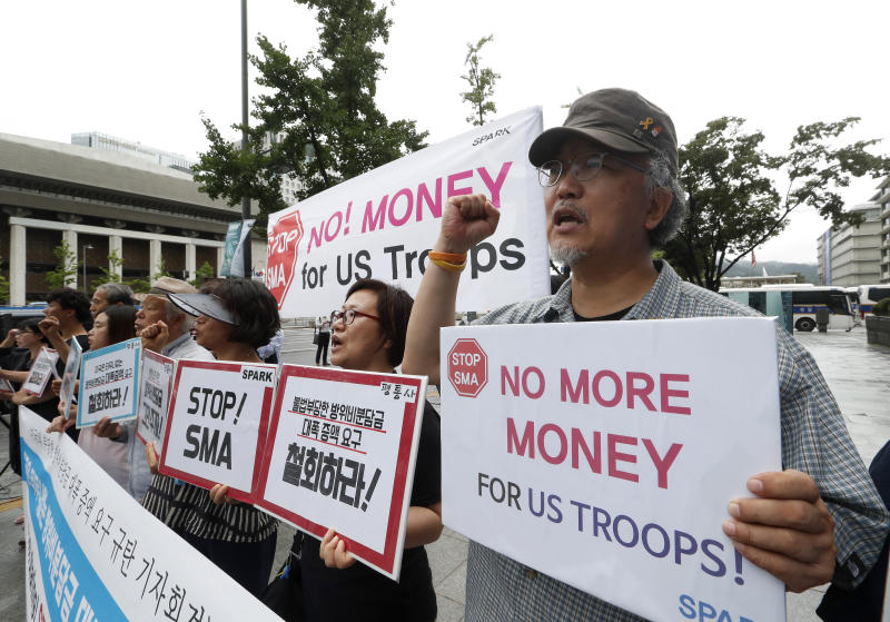 "South Korean protesters shout slogans during a rally demanding withdrawal of the U.S. troops from Korea peninsular near the U.S. embassy in Seoul, South Korea, Wednesday, July 31, 2019. North Korea fired two short-range ballistic missiles off its east coast Wednesday, South Korea's military said, its second weapons test in less than a week. North Korea is angry over planned U.S.-South Korean military drills and may be trying to boost pressure on the United States to win concessions as the rivals struggle to set up talks over the North's nuclear weapons. The Korean letters read: ""We denounce the Special Measures Agreement."" (AP Photo/Ahn Young-joon)"