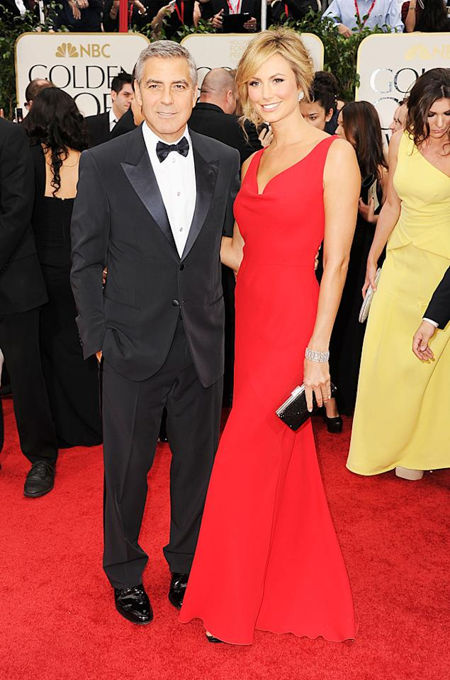 """<b>George Clooney and Stacy Keibler</b><br><b>Grade: A</b><br><br><span style=""""font-family:Arial;"""">When you're as attractive as Best Actor winner George Clooney (""""The Descendants"""") and Stacey Keibler, it's really hard to flop on the red carpet. The Cloon looked dashing as always in Giorgio Armani, while his statuesque main squeeze was ravishing in a red Valentino column gown that he helped her pick out. </span>"""