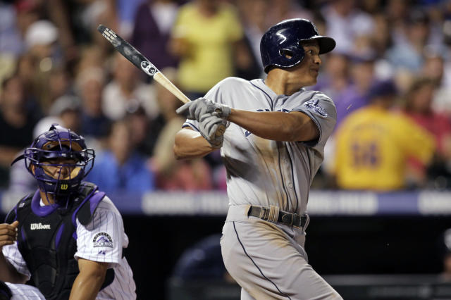 San Diego Padres Will Venable breaks his bat as he hits a single in the sixth inning of a baseball game against the Colorado Rockies in Denver on Tuesday, Aug. 13, 2013. Rockies catcher Wilin Rosario watches. (AP Photo/Joe Mahoney)