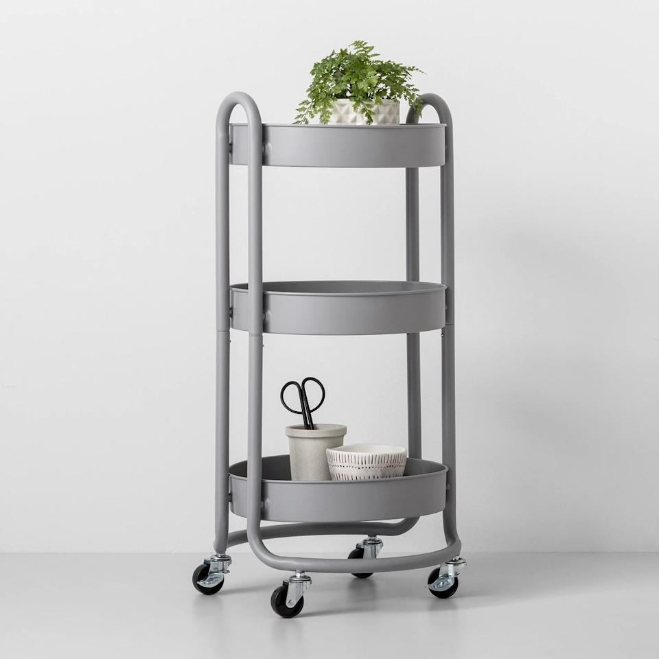 "<p>Roll this <a href=""https://www.popsugar.com/buy/Round-Metal-Utility-Cart-461418?p_name=Round%20Metal%20Utility%20Cart&retailer=target.com&pid=461418&price=35&evar1=casa%3Aus&evar9=46500928&evar98=https%3A%2F%2Fwww.popsugar.com%2Fphoto-gallery%2F46500928%2Fimage%2F46500993%2FRound-Metal-Utility-Cart&list1=target%2Corganization%2Cbathrooms&prop13=api&pdata=1"" rel=""nofollow"" data-shoppable-link=""1"" target=""_blank"" class=""ga-track"" data-ga-category=""Related"" data-ga-label=""https://www.target.com/p/round-metal-utility-cart-made-by-design-153/-/A-53308484?preselect=53166286#lnk=sametab"" data-ga-action=""In-Line Links"">Round Metal Utility Cart</a> ($35) into your bathroom to hold extra items like towels, makeup, bathroom products, and more. </p>"