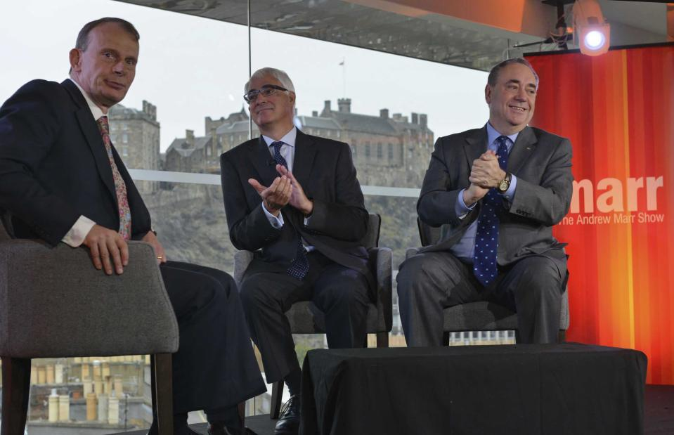 Alistair Darling (C), the leader of the campaign to keep Scotland part of the United Kingdom, appears with Scotland's First Minister Alex Salmond (R) on the BBC's Andrew Marr Show in Edinburgh, this photograph received via the BBC in London September 14, 2014. The referendum on Scottish independence will take place on September 18, when Scotland will vote whether or not to end the 307-year-old union with the rest of the United Kingdom. REUTERS/Jeff Overs/BBC/Handout via Reuters (BRITAIN - Tags: POLITICS ELECTIONS) ATTENTION EDITORS - THIS IMAGE HAS BEEN SUPPLIED BY A THIRD PARTY. IT IS DISTRIBUTED, EXACTLY AS RECEIVED BY REUTERS, AS A SERVICE TO CLIENTS. NO COMMERCIAL OR BOOK SALES. NO SALES. NO ARCHIVES. FOR EDITORIAL USE ONLY. NOT FOR SALE FOR MARKETING OR ADVERTISING CAMPAIGNS