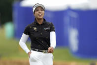 Patty Tavatanakit of Thailand smiles as she walks off the course after finishing on the 18th hole, during the third round of play in the KPMG Women's PGA Championship golf tournament Saturday, June 26, 2021, in Johns Creek, Ga. (AP Photo/John Bazemore)