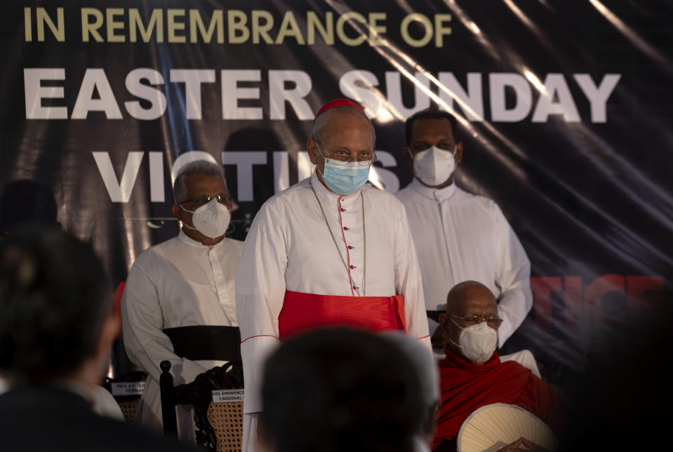 Cardinal Malcolm Ranjith, archbishop of Colombo, center, observes two minute silence for the victims of 2019 Easter Sunday attacks during a service at St. Anthony's Church in Colombo, Sri Lanka, Wednesday, April 21, 2021. Wednesday marked the second anniversary of the serial blasts that killed 269 people. (AP Photo/Eranga Jayawardena)