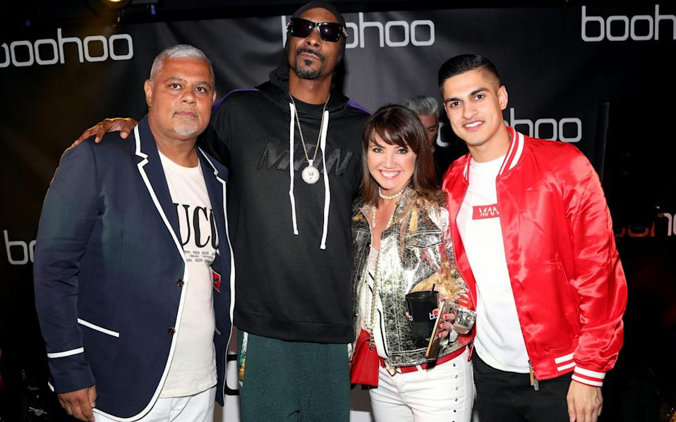 Mahmud Kamani, Snoop Dogg Carol Kane and Samir Kamani attend the launch of the boohoo.com spring collection in 2018 - Jerritt Clark/Getty Images North America