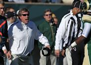 Colorado State head coach Jim McElwain, left, argues a defensive pass interference call against his team while facing Air Force in the first quarter of an NCAA football game in Fort Collins, Colo., on Saturday, Nov. 30, 2013. (AP Photo/David Zalubowski)