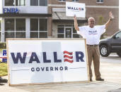 Bob Rosson holds a sign supporting Bill Waller during a primary runoff election at the Oxford Conference Center in Oxford, Miss. on Tuesday, Aug. 27, 2019. Mississippi voters are choosing a Republican nominee for governor, either second-term Lt. Gov. Tate Reeves or retired state Supreme Court Chief Justice Bill Waller. (Bruce Newman/The Oxford Eagle via AP)