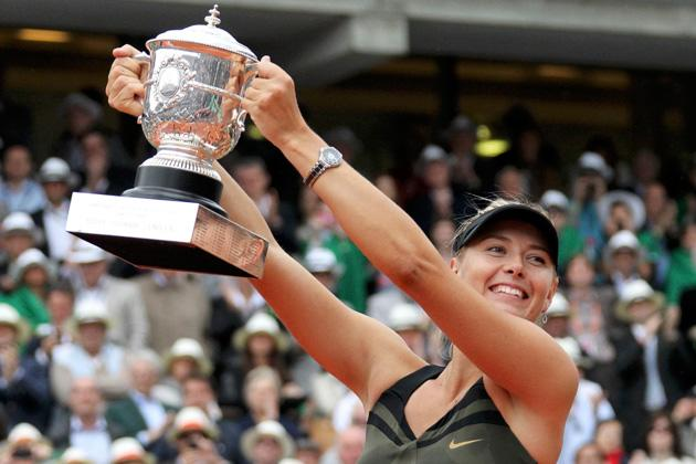 Maria Sharapova of Russia holds the trophy as she poses during the ceremony after defeating Sara Errani of Italy during their women's singles final match at the French Open tennis tournament at the Roland Garros stadium in Paris June 9, 2012.                              REUTERS/Regis Duvignau