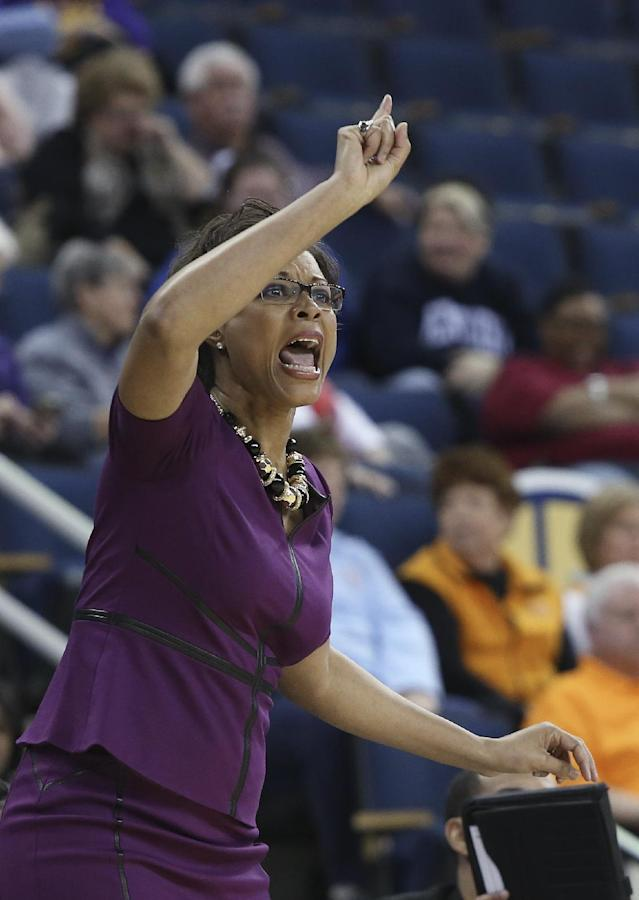 LSU coach Nikki Caldwell talks to her players during the first half of an NCAA college basketball game against Tennessee in the quarterfinals of the Southeastern Conference women's tournament, Friday, March 7, 2014, in Duluth, Ga. (AP Photo/Jason Getz)