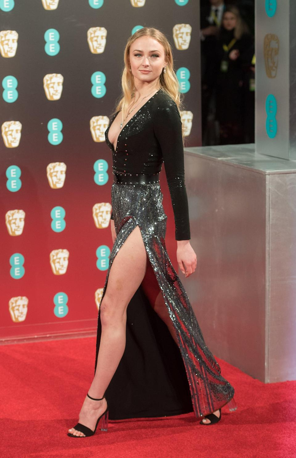 <p>Sophie worked the thigh-high slit on this ombré effect sequined Louis Vuitton dress at the 2017 BAFTAs, finishing the look with a lucite platform sandal, also by LV.</p>