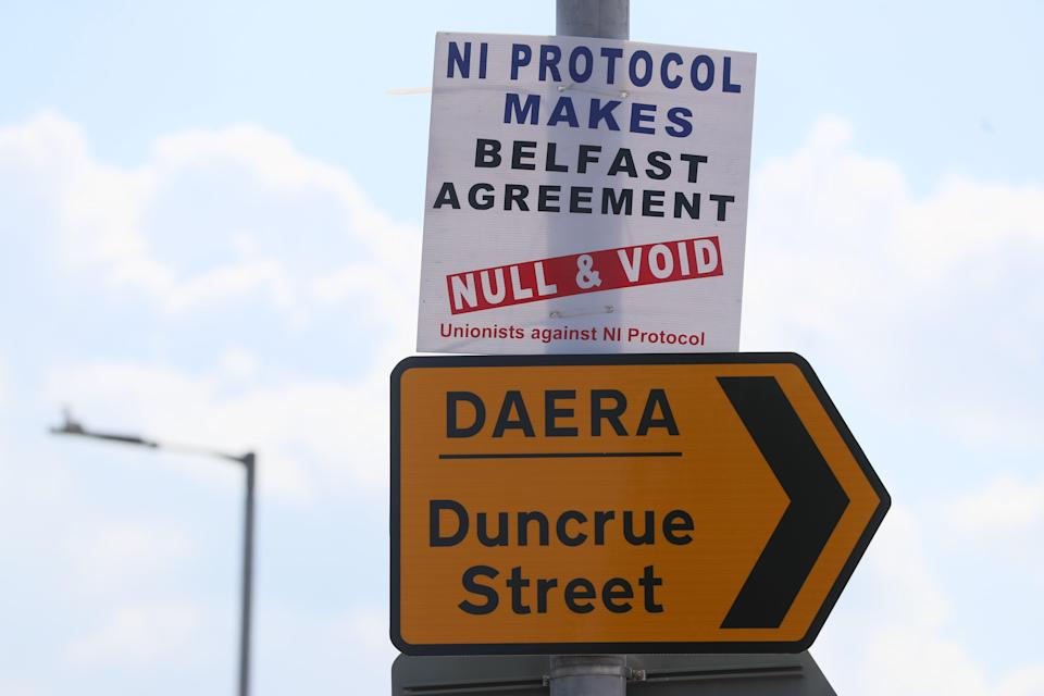 A protest sign near Belfast's harbour (PA)