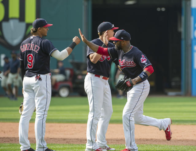 Cleveland Indians' Erik Gonzalez, left, and Austin Jackson celebrate after defeating the Kansas City Royals and winning the American League Central Division after a baseball game in Cleveland, Sunday, Sept. 17, 2017. (AP Photo/Phil Long)