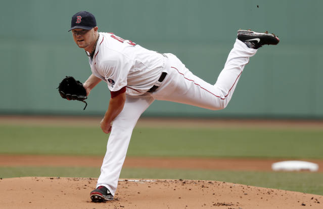 Boston Red Sox starting pitcher Jon Lester delivers against the New York Yankees during the first inning of a baseball game at Fenway Park in Boston Saturday, Sept. 14, 2013. (AP Photo/Winslow Townson)