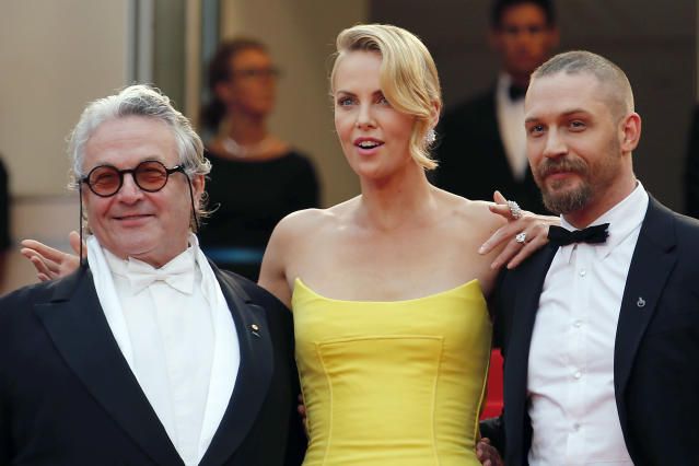 "(L-R) Director George Miller, cast members Charlize Theron and Tom Hardy pose on the red carpet as they arrive for the screening of the film ""Mad Max: Fury Road"" out of competition at the 68th Cannes Film Festival in Cannes, southern France, May 14, 2015. REUTERS/Regis Duvignau"