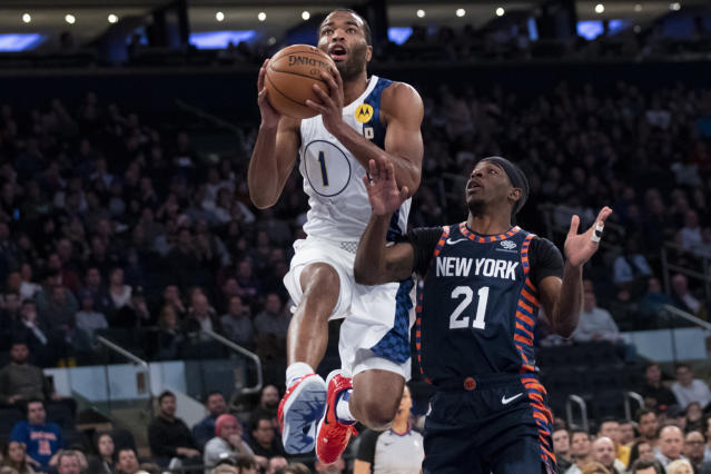 Indiana Pacers forward T.J. Warren (1) goes to the basket past New York Knicks guard Damyean Dotson (21) in the first half of an NBA basketball game, Saturday, Dec. 7, 2019, at Madison Square Garden in New York. (AP Photo/Mary Altaffer)