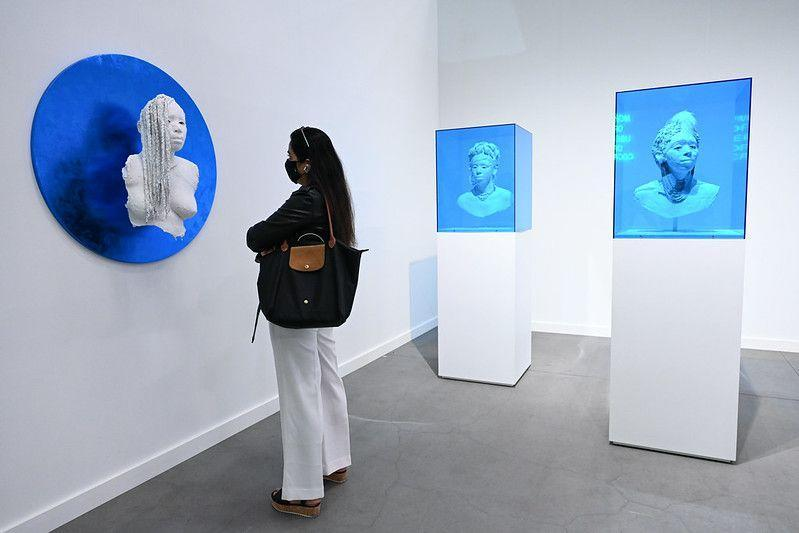 """<p>This standout installation from Los Angeles–based Wilding Cran Gallery featured the work of Karon Davis. The artist, who founded the city's celebrated <a href=""""https://theunderground-museum.org/"""" rel=""""nofollow noopener"""" target=""""_blank"""" data-ylk=""""slk:Underground Museum"""" class=""""link rapid-noclick-resp"""">Underground Museum</a> in 2012 with her husband, the late artist Noah Davis, is increasingly moving into the spotlight with her beautiful yet urgent works. Her Frieze New York presentation (which came on the heels of her first solo <a href=""""https://www.nytimes.com/2021/03/31/arts/design/karon-davis-underground-museum-deitch.html"""" rel=""""nofollow noopener"""" target=""""_blank"""" data-ylk=""""slk:show"""" class=""""link rapid-noclick-resp"""">show</a> in New York at Jeffrey Deitch) features a series of enigmatic busts created from plaster strips over a steel armature. The classical sculptures of Black women—some in blue vitrines, others jutting from a tondo covered in blue metal leaf—exude both delicacy and power and beckon you to take a closer look.</p>"""
