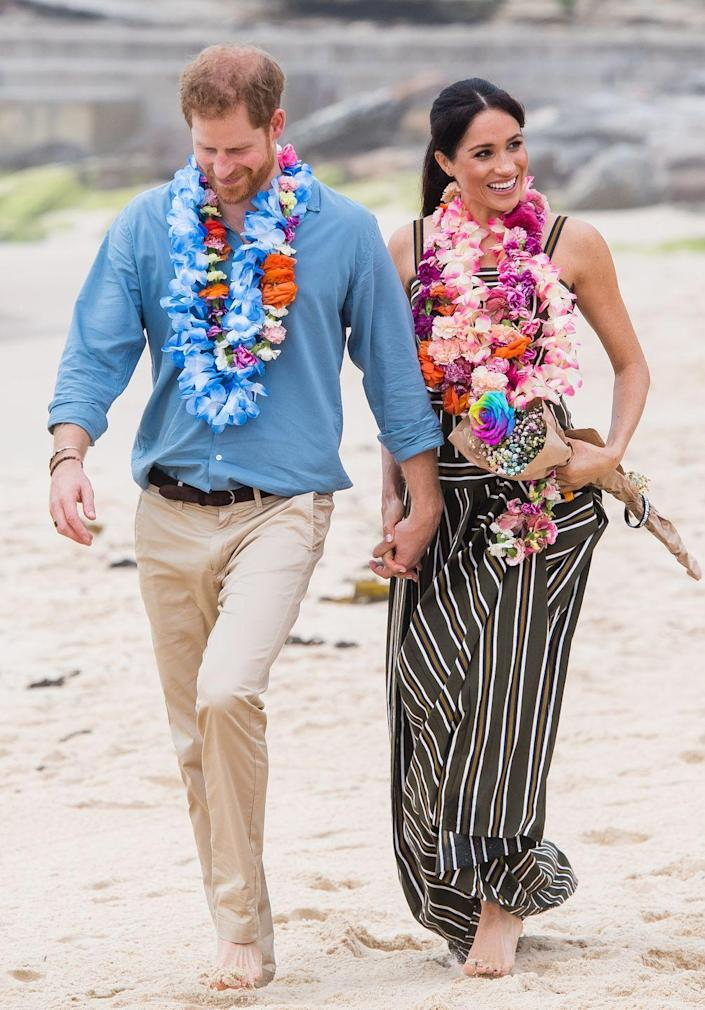 """<p>The pair made headlines when they appeared extra casual on Bondi Beach during their oceanic visit. They were compared to previous royals, who kept their sandy shoes on during beach visits, in an <a href=""""https://www.yahoo.com/news/barefoot-meghan-markle-prince-harry-break-royal-protocol-131523311.html"""" data-ylk=""""slk:internet debate over royal protocol;outcm:mb_qualified_link;_E:mb_qualified_link;ct:story;"""" class=""""link rapid-noclick-resp yahoo-link"""">internet debate over royal protocol</a>.</p>"""