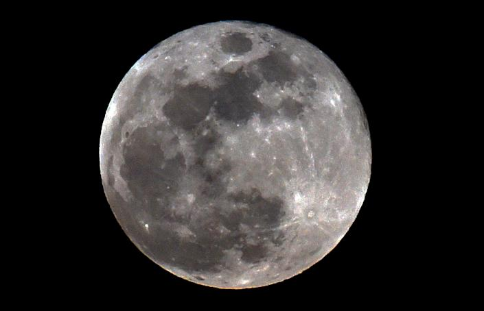 The full moon is seen during a penumbral lunar eclipse in Mexico City on June 5, 2020. A penumbral lunar eclipse will occur over the Americas during the overnight of July 4-5, 2020.