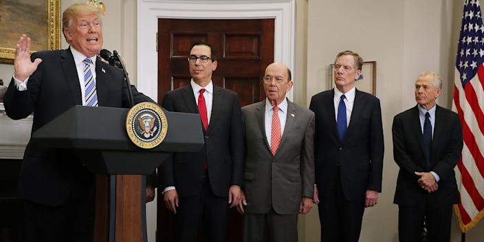 """President Donald Trump with members of his Cabinet: Treasury Secretary Steven Mnuchin, Commerce Secretary Wilbur Ross, US Trade Representative Robert Lighthizer and White House National Trade Council Director Peter Navarro. <p class=""""copyright"""">Chip Somodevilla/Getty Images</p>"""