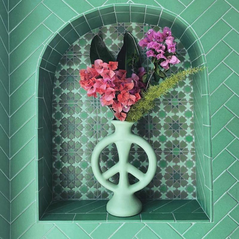 <p>Bring on all the peaceful vibes with this <span>Jungalow Peace Vase by Justina Blakeney</span> ($68).</p>
