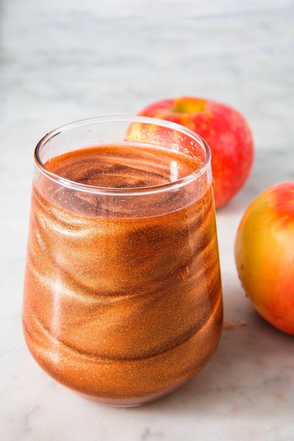 """<p>It's allll about the edible glitter. </p><p>Get the recipe from <a href=""""https://www.delish.com/cooking/recipe-ideas/a23878264/poison-apple-cocktails-recipe/"""" rel=""""nofollow noopener"""" target=""""_blank"""" data-ylk=""""slk:Delish"""" class=""""link rapid-noclick-resp"""">Delish</a>. </p>"""