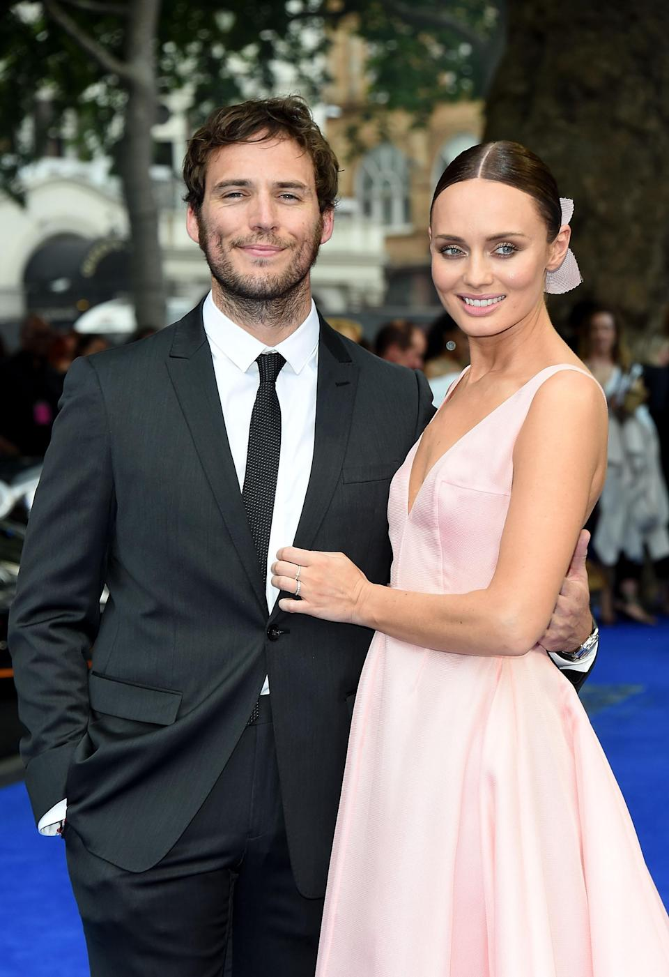 Sam Claflin says he'd rather spend time with his wife, Laura Haddock, and their two children than be an activist (Getty)