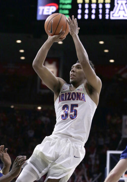 FILE - In this Nov. 16, 2017, file photo, Arizona guard Allonzo Trier (35) shoots in the second half during an NCAA college basketball game against Cal State Bakersfield, in Tucson, Ariz. Trier is averaging 30 points per game for the Wildcats entering the Battle 4 Atlantis tournament. (AP Photo/Rick Scuteri, File)
