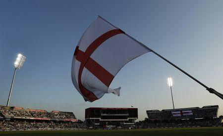 FILE PHOTO - Britain Cricket - England v Pakistan - NatWest International T20 - Emirates Old Trafford - 7/9/16 The England flag is waved before the start of the match Action Images via Reuters / Lee Smith