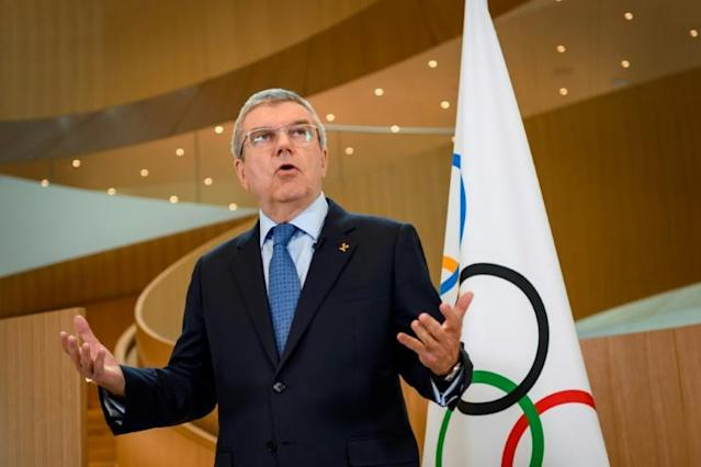 Thomas Bach and the IOC do not deserve criticism over delaying a decision on the Tokyo Olympics as it is mind bogglingly complex to re-organise former IOC marketing director Michael Payne told AFP (AFP Photo/Fabrice COFFRINI)