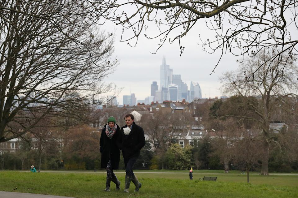 People walk in Brockwell Park, as the spread of the coronavirus disease (COVID-19) continues, London, Britain, March 30, 2020. REUTERS/Hannah McKay