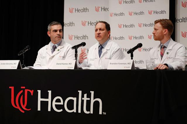 <p>Daniel Kanter, medical director of the Neuroscience Intensive Care Unit, center, speaks alongside Jordan Bonomo, a neurointensivist, left, and Brandon Foreman, a neurointensive care specialist, right, during a news conference regarding Otto Warmbier's condition, at University of Cincinnati Medical Center in Cincinnati, Ohio. (Photo: John Minchillo/AP). </p>