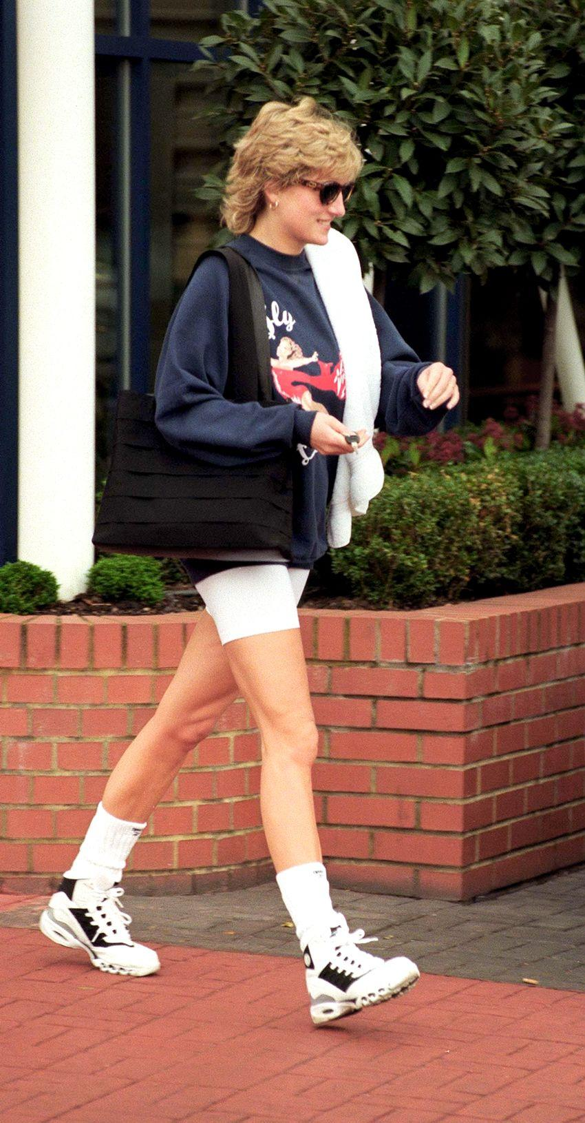 WHO: Princess Diana. Style Notes: Another winning bike shorts ensemble that proves sometimes the simplest combos are often the best. Here, Princess Diana's oversize crewneck sweatshirt, tube socks, and chunky-soled sneakers may be coming from the gym, but we'd gladly wear them together to lounge or run errands on the weekend, too.