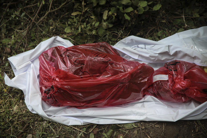 Human remains lie in an evidence bag, dug from a clandestine grave site in Arbolillo, Veracruz state, Mexico, Friday, Sept. 7, 2018. One day after authorities in the Mexican state of Veracruz announced the discovery of at least 166 skulls in mass graves, journalists who arrived at the site Friday discovered it was the same location where authorities said they had found 47 bodies the previous year. (AP Photo/Felix Marquez)