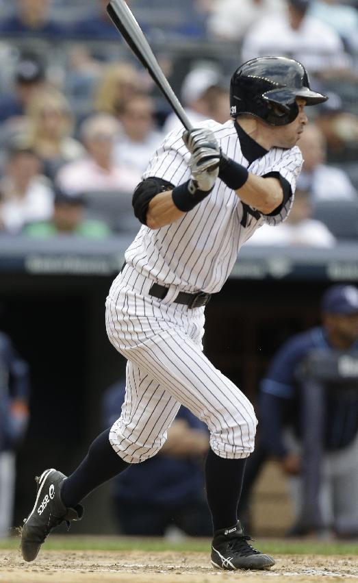 New York Yankees' Ichiro Suzuki, of Japan, follows through with a double during the fifth inning of a baseball game against the Tampa Bay Rays Saturday, May 3, 2014, in New York. (AP Photo/Frank Franklin II)