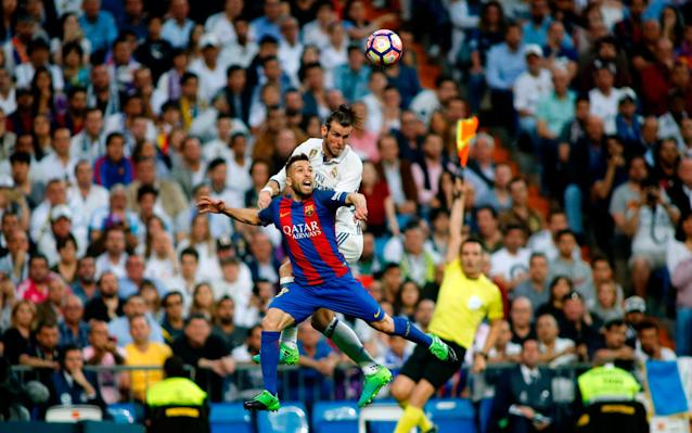 <span>Bale leaps above Jordi Alba in the small portion of El Clasico he featured in</span> <span>Credit: AFP </span>