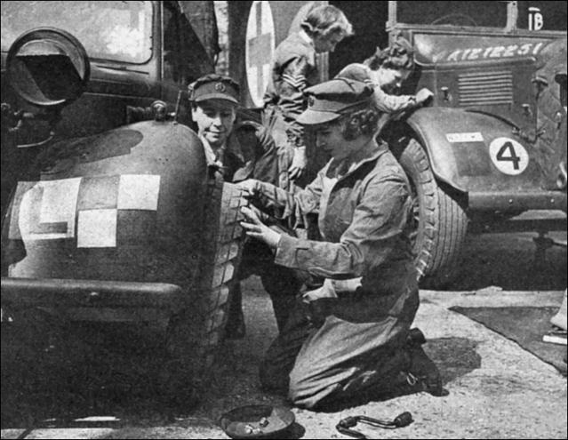 Princess Elizabeth learning how to change a car wheel as an auxiliary-officer of the English Army, 1945. (Getty Images)