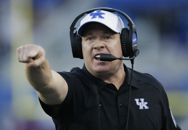 FILE - In this Sept. 30, 2017, file photo, Kentucky head coach Mark Stoops yells to his team during the second half of an NCAA college football game against Eastern Michigan, in Lexington, Ky. No. 25 Florida (1-0) is seeking its 32nd consecutive victory against Kentucky (1-0) when the teams open Southeastern Conference play in the Swamp on Saturday. Its the longest active streak in an uninterrupted series and the fourth-longest in NCAA history. Stoops openly embraces the streak, knowing what it would mean to end it. (AP Photo/David Stephenson, File)