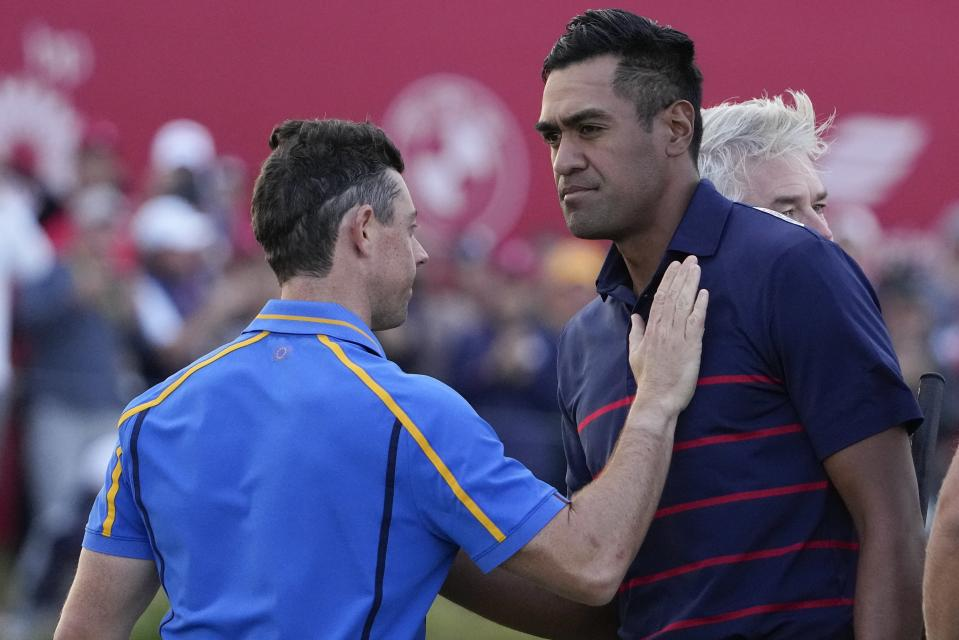 Team Europe's Rory McIlroy congratulates Team USA's Tony Finau after a four-ball match the Ryder Cup at the Whistling Straits Golf Course Friday, Sept. 24, 2021, in Sheboygan, Wis. (AP Photo/Jeff Roberson)