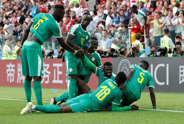 Soccer Football - World Cup - Group H - Poland vs Senegal - Spartak Stadium, Moscow, Russia - June 19, 2018 Senegal's M'Baye Niang celebrates scoring their second goal with team mates REUTERS/Grigory Dukor