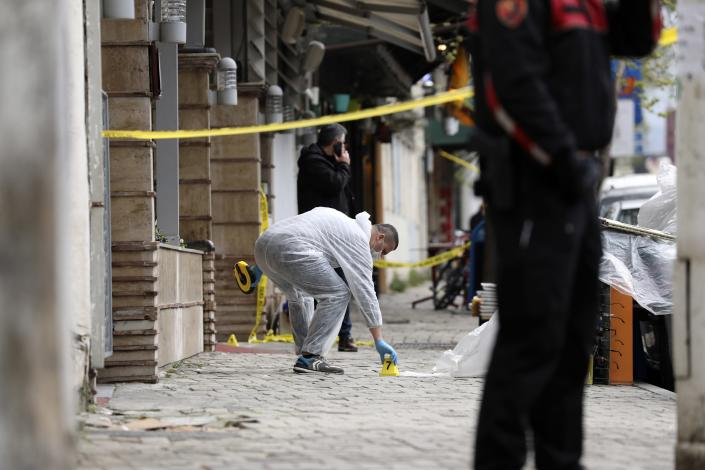 A policeman investigates the area outside Dine Hoxha mosque after a knife attack in Tirana, Albania, Monday, April 19, 2021. Monday, April 19, 2021. Police say an Albanian man with a knife has attacked five people at a mosque in the capital of Tirana. A police statement said Rudolf Nikolli, 34, entered the Dine Hoxha mosque in downtown Tirana about 2:30 p.m. and wounded five people with a knife. (AP Photo)