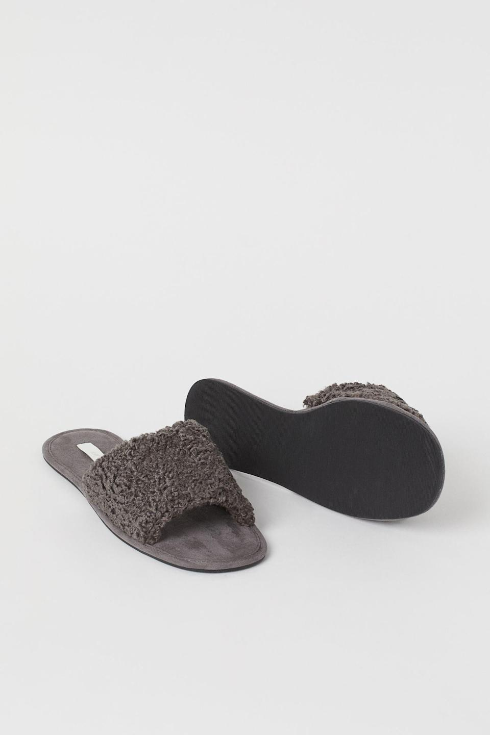 <p>Add these cozy <span>Faux Shearling Slippers</span> ($18) to your minimalist wardrobe of black, white, and gray pieces.</p>