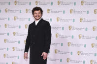 Actor Pedro Pascal poses for photographers upon arrival at the Bafta Film Awards, in central London, Sunday, April 11 2021. (AP Photo/Alberto Pezzali)