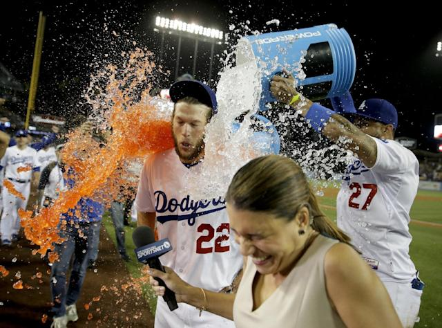 Los Angeles Dodgers starting pitcher Clayton Kershaw celebrates his no-hitter against the Colorado Rockies after a baseball game in Los Angeles, Wednesday, June 18, 2014. (AP Photo/Chris Carlson)