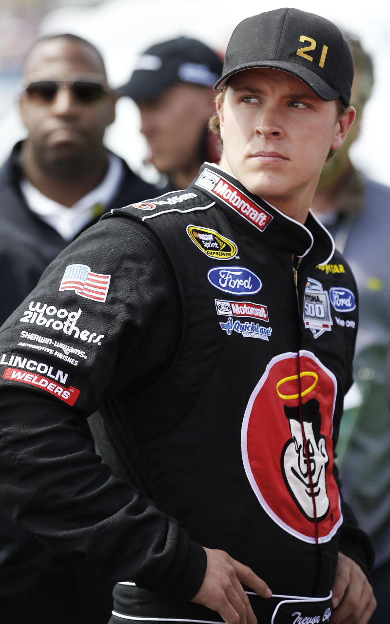 Driver Trevor Bayne walks in the garage area during qualifying for Sunday's Aaron's 499 NASCAR Sprint Cup series auto race at the Talladega Superspeedway, Saturday, April 16, 2011, in Talladega, Ala. (AP Photo/Butch Dill)