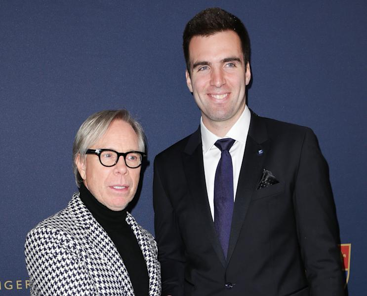 This image released by Starpix shows designer Tommy Hilfiger, left, with Baltimore Ravens quarterback Joe Flacco at the Tommy Hilfiger Men's Fall 2013 collection, Friday, Feb. 8, 2013 during Fashion Week in New York. (AP Photo/Starpix, Andrew Toth)
