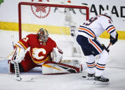 Edmonton Oilers' Leon Draisaitl, right, of Germany, has his shot kicked away by Calgary Flames goalie David Rittich, of the Czech Republic, during the first period of an NHL hockey game Saturday, Nov. 17, 2018, in Calgary, Alberta. (Jeff Macintosh/The Canadian Press via AP)