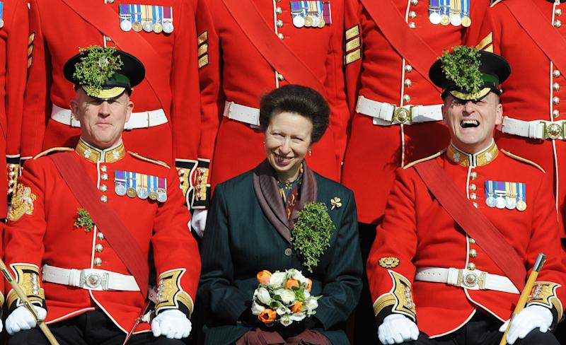 WINDSOR, ENGLAND - MARCH 17: HRH Princess Anne, The Princess Royal poses with guards during a visit to see the 1st Battalion Irish Guards doing a St Patrick's Day Parade at their new home, Victoria Barracks, on March 17, 2009 in Windsor, England. (Photo by Anwar Hussein/WireImage)