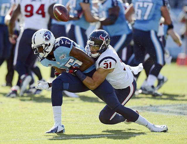 Houston Texans free safety Shiloh Keo (31) breaks up a pass intended for Tennessee Titans wide receiver Justin Hunter (15) in the first quarter of an NFL football game Sunday, Dec. 29, 2013, in Nashville, Tenn. (AP Photo/Mark Zaleski)